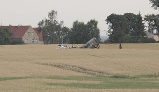 The damaged body of a Polish Air Force MiG-29 jet that crashed in the fields in the country's north during a night training flight, near the town of Paslek, in Poland, on Friday, July 6, 2018. The Polish Air Force pilot of the Soviet-made jet was killed, despite ejecting before the crash.(AP Photo/TVN24)