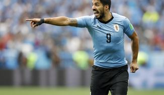 Uruguay's Luis Suarez points during the quarterfinal match between Uruguay and France at the 2018 soccer World Cup in the Nizhny Novgorod Stadium, in Nizhny Novgorod, Russia, Friday, July 6, 2018. (AP Photo/David Vincent)