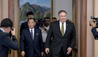 U.S. Secretary of State Mike Pompeo, right, and Kim Yong Chol, left, a North Korean senior ruling party official and former intelligence chief, return to discussions after a break at Park Hwa Guest House in Pyongyang, North Korea, Saturday, July 7, 2018. (AP Photo/Andrew Harnik, Pool) **FILE**