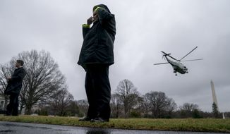 Secret Service agents stand on the South Lawn as Marine One with President Donald Trump aboard departs the White House in Washington, Friday, Feb. 23, 2018, to travel to Oxon Hill, Md. to speak at the Conservative Political Action Conference (CPAC). (AP Photo/Andrew Harnik)