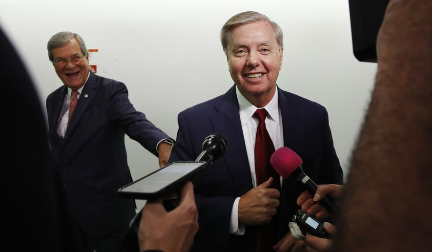 Sen. Lindsey Graham, R-S.C., right, jokes with former Sen. Trent Lott, R-Miss., left, before answering reporters questions about the retirement of Supreme Court Justice Anthony Kennedy Wednesday, June 27, 2018, on Capitol Hill in Washington. (AP Photo/Jacquelyn Martin)
