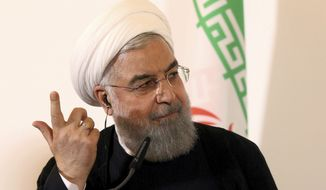 Iranian President Hassan Rouhani speaks during a joint news conference as part of a meeting with Austria's Chancellor Sebastian Kurz at the federal chancellery in Vienna, Austria, Wednesday, July 4, 2018. (AP Photo/Ronald Zak)
