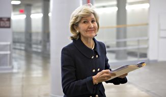 "After nearly two decades as the first woman to represent Texas in the U.S. Senate, Sen. Kay Bailey Hutchison, R-Texas, walks to the floor of the Senate to give her farewell speech, at the Capitol in Washington, Wednesday, Dec. 12, 2012.  In the chamber, Sen. Hutchison became emotional as she recalled her ""Homaker's IRA"" legislation which gave homemakers - men and women - the same rights to establish an Individual Retirement Account, or IRA, as their working spouses.  (AP Photo/J. Scott Applewhite)"