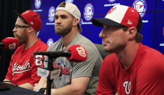 From left to right, Washington Nationals pitcher Sean Doolittle, right fielder Bryce Harper and pitcher Max Scherzer speak to reporters during a news conference at Nationals Park in Washington, Sunday, July 8, 2018. Doolittle, Harper and Scherzer are representing the Nationals in the All-Star Game on July 17. (AP Photo/Manuel Balce Ceneta)