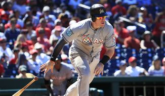 Miami Marlins' Justin Bour follows the ball as he runs to first base during the sixth inning of a baseball game against the Washington Nationals in Washington, Sunday, July 8, 2018. Bour grounded out to first. (AP Photo/Manuel Balce Ceneta)