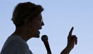 Sen. Elizabeth Warren, D-Mass., addresses an audience at Belkin Family Lookout Farm during a town hall event, Sunday, July 8, 2018, in Natick, Mass. Warren is hosting the town hall and cookout following an Independence Day trip to visit U.S. troops in Iraq and Kuwait. (AP Photo/Steven Senne)