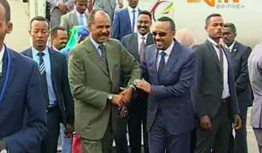 Eritrean President Isaias Afwerki (left) welcomed Ethiopian Prime Minister Abiy Ahmed to Asmara on Sunday. With laughter and hugs, the leaders of the longtime rivals declared an end to one of Africa's longest and bloodiest border disputes. (Associated Press)