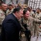 Secretary of State Mike Pompeo took a photograph with a member of the U.S. military on Monday as he met briefly with coalition forces at Bagram Air Base in Afghanistan. (Associated Press)