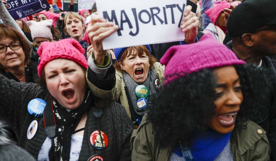 Protesters cheer at the Women's March on Washington during the first full day of Donald Trump's presidency, Saturday, Jan. 21, 2017, in Washington. (AP Photo/John Minchillo)