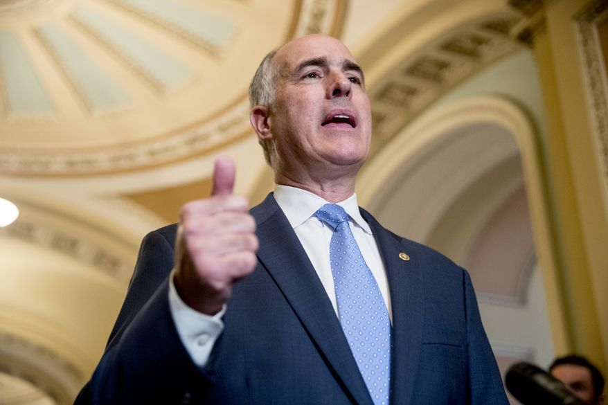 Sen. Bob Casey, Jr., D-Pa., speaks with reporters following a closed door policy luncheon on Capitol Hill in Washington, Tuesday, June 26, 2018. (AP Photo/Andrew Harnik)