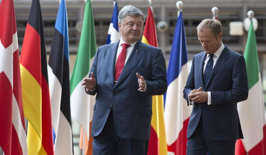 European Council President Donald Tusk, right, speaks with Ukraine's President Petro Poroshenko during arrival for an EU-Ukraine summit at the Europa building in Brussels on Monday, July 9, 2018. (AP Photo/Virginia Mayo)