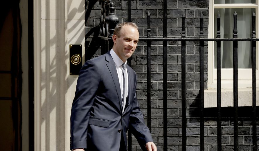 Britain's new Secretary of State for Exiting the European Union Dominic Raab leaves 10 Downing Street after it was announced he was appointed to the job in London, Monday, July 9, 2018. Former Housing Minister Dominic Raab is to take up the post, after U.K. Brexit Secretary David Davis resigned from the Cabinet and said Monday that he won't seek to challenge Prime Minister Theresa May's leadership. (AP Photo/Matt Dunham)