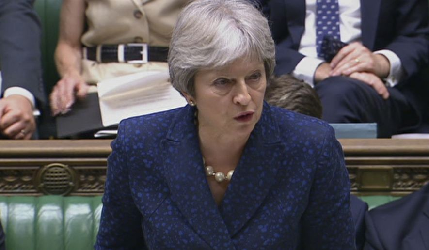 In this image from TV, Britain's Prime Minister Theresa May gives statement in the parliament Monday July 9, 2018. British Foreign Secretary Boris Johnson resigned Monday, adding to divisions over Brexit that threaten to tear apart Prime Minister Theresa May's government.(Parliamentary Recording Unit via AP)