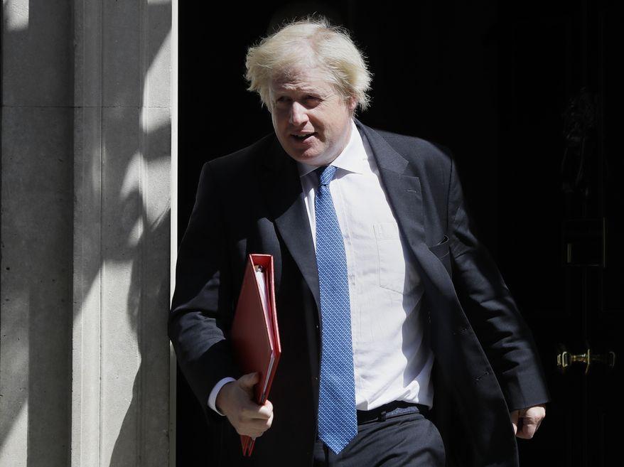 In this file photo dated Wednesday, June 13, 2018, Britain's Foreign Minister Boris Johnson leaves 10 Downing Street in London.  UK Foreign Secretary Boris Johnson has resigned Monday July 9, 2018, amid Cabinet splits over Brexit.(AP Photo/Kirsty Wigglesworth, File)