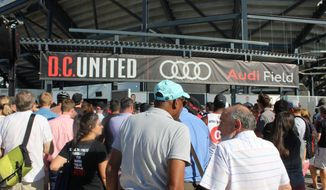 Fans of Major League Soccer club D.C. United enter Audi Field, the club's new stadium in Washington, D.C., at its ribbon-cutting ceremony on Monday, July 9, 2018. (Photo by Adam Zielonka / The Washington Times)