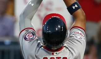 Washington Nationals' Juan Soto celebrates as he crosses home plate after hitting a solo home run off Pittsburgh Pirates starting pitcher Ivan Nova in the fifth inning of a baseball game in Pittsburgh, Monday, July 9, 2018. (AP Photo/Gene J. Puskar)