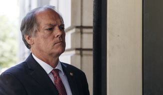 Former Senate Select Committee on Intelligence staffer James Wolfe arrives at the federal courthouse, Monday, July 9, 2018, in Washington. (AP Photo/Carolyn Kaster)