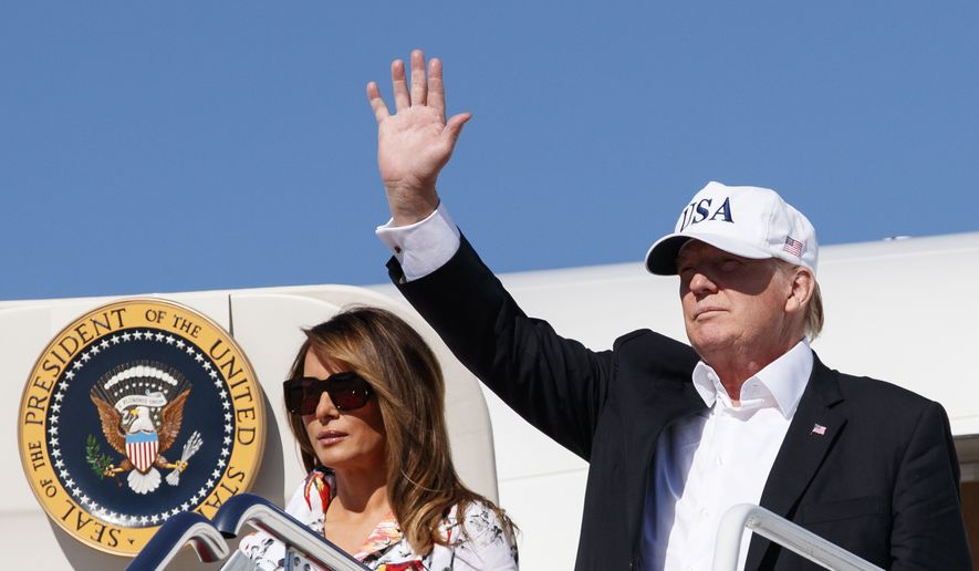 President Donald Trump and first lady Melania Trump arrive on Air Force One, Sunday, July 8, 2018, in Andrews Air Force Base, Md., en route to Washington as they return from Trump National Golf Club in Bedminster, N.J.. (AP Photo/Carolyn Kaster)