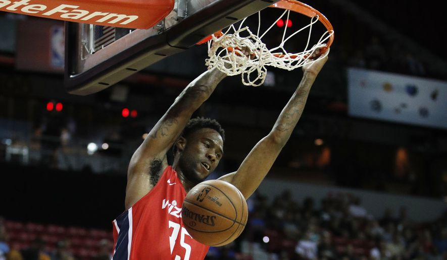 Washington Wizards' Tiwian Kendley dunks against the Philadelphia 76ers during the second half of an NBA Summer League basketball game Monday, July 9, 2018, in Las Vegas. (AP Photo/John Locher) ** FILE **