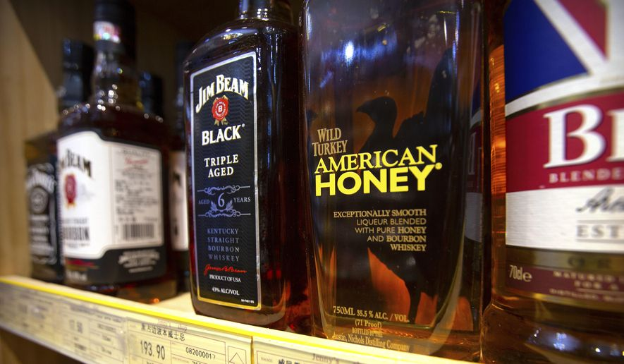In this Saturday, July 7, 2018, file photo, whiskeys distilled and bottled in the U.S. are displayed for sale in a grocery store in Beijing. (AP Photo/Mark Schiefelbein, File)