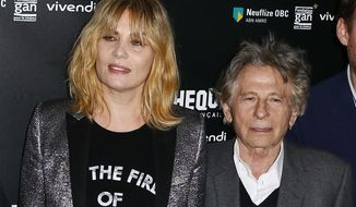 "FILE - In this Oct. 30, 2017 file photo, French actress Emmanuelle Seigner, left, and French-Polish director Roman Polanski appear during a photo call prior to the screening of ""Based on a true story"" in Paris. Seigner refused the invitation of the Academy of Motions Pictures Arts & Sciences and voiced her support for her expelled husband, Polanski, who was kicked out of the organization in May, along with Bill Cosby, for violating its newly instituted code of conduct. (AP Photo/Francois Mori, File)"