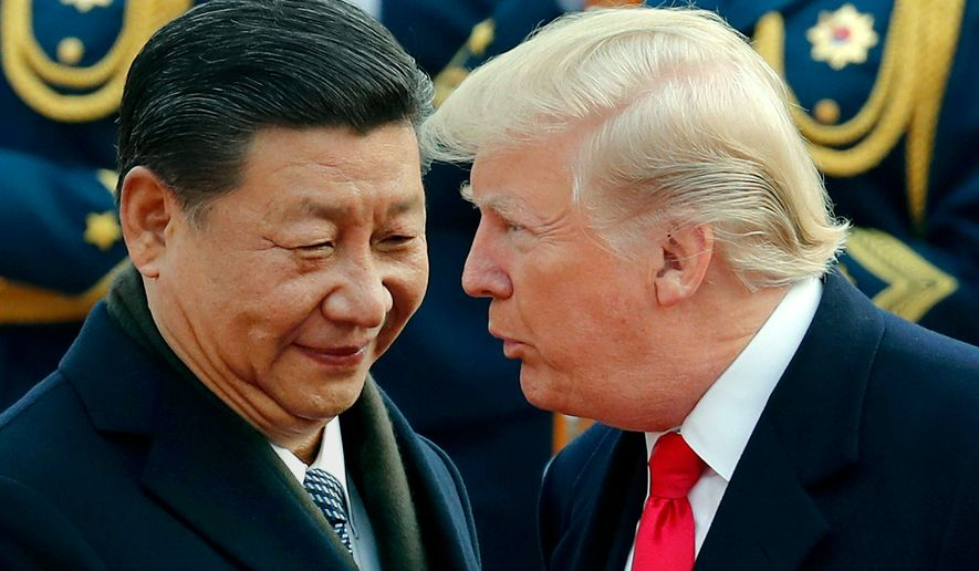 In this Nov. 9, 2017, file photo, U.S. President Donald Trump, right, chats with Chinese President Xi Jinping during a welcome ceremony at the Great Hall of the People in Beijing. Critics fear foreign government favors to Trump businesses have become business as usual. Ethics watchdogs say apparent quid-pro-quo deals are not being stopped by a Republican-led Congress or the courts. (AP Photo/Andy Wong, File)