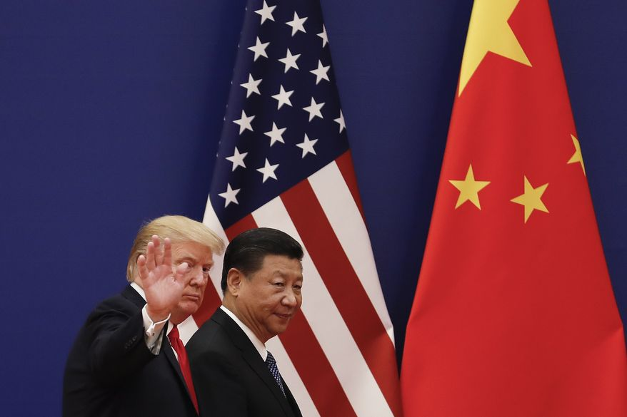 FILE - In this Nov. 9, 2017 file photo, U.S. President Donald Trump waves next to Chinese President Xi Jinping after attending a business event at the Great Hall of the People in Beijing. U.S. President Donald Trump's abrupt withdrawal from his planned summit with North Korea raises the stakes for China to show that it can steer the North toward easing tensions over its nuclear program. But despite a recent warming in ties, Beijing's influence over its neighbor may be overstated. (AP Photo/Andy Wong, File)