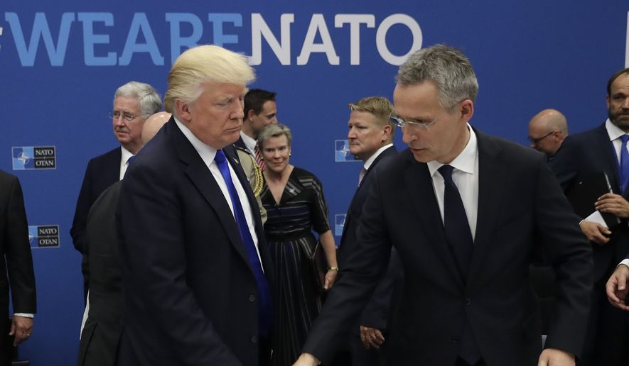 In this Thursday, May 25, 2017, file photo, U.S. President Donald Trump, left, and NATO Secretary General Jens Stoltenberg take a seat during a working dinner at a NATO summit in Brussels. When Donald Trump walks into a NATO summit Wednesday, July 11, 2018,  international politics are bound to become intensely personal _ again. (AP Photo/Matt Dunham, Pool, File)