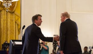 President Donald Trump shakes hands with Brett Kavanaugh, his Supreme Court nominee, in the East Room of the White House, Monday, July 9, 2018, in Washington. (AP Photo/Evan Vucci)