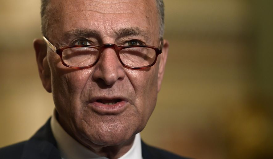 Senate Minority Leader Sen. Chuck Schumer of N.Y., speaks to reporters on Capitol Hill in Washington, Tuesday, July 10, 2018. (AP Photo/Susan Walsh)