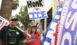 Members of Patriot Movement AZ gather outside of the U.S. Immigration Customs and Enforcement Removal Operations Field Offices in Phoenix, Tuesday, July 10, 2018, calling for support of ICE and strengthening the country's borders. (AP Photo/Annika Wolters)