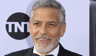 In this Thursday, June 7, 2018, file photo, George Clooney arrives at the 46th AFI Life Achievement Award Honoring himself at the Dolby Theatre in Los Angeles. Italian media say actor George Clooney has been hospitalized after he was involved in an accident while riding a motorcycle in Sardinia it was reported on Tuesday, July 10, 2018. Local daily La Nuova Sardegna says Clooney's injuries aren't serious, but that he was taken to the John Paul II hospital emergency room. Police said they have no information, and the hospital didn't respond to requests for comment. (Photo by Willy Sanjuan/Invision/AP, File)