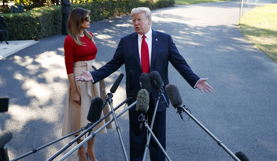 First lady Melania Trump looks on as President Donald Trump speaks with reporters before boarding Marine One on the South Lawn of the White House, Tuesday, July 10, 2018, in Washington. (AP Photo/Evan Vucci)