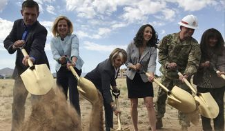 Officials break ground for a new multimillion-dollar new complex that will house employees of the National Nuclear Security Administration in Albuquerque, N.M. Albuquerque with a population of about 600,000, lands thriving tech companies and piles of U.S. military contracts. (AP Photo/Susan Montoya Bryan)