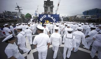 Navy sailors are dismissed after a rededication ceremony for the USS John S. McCain at the U.S. Naval base in Yokosuka, southwest of Tokyo, Thursday, July 12, 2018. Navy Secretary Richard Spencer dedicated one of two destroyers involved in fatal accidents in the Pacific last year to Sen. John McCain.  (AP Photo/Eugene Hoshiko)
