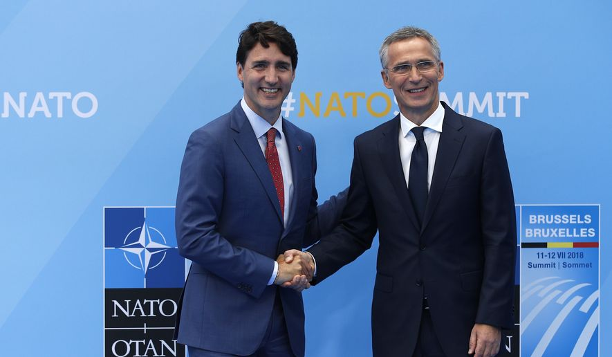 Canadian Prime Minister Justin Trudeau, left, is greeted by NATO Secretary General Jens Stoltenberg before a summit of heads of state and government at NATO headquarters in Brussels on Wednesday, July 11, 2018. NATO leaders gather in Brussels for a two-day summit to discuss Russia, Iraq and their mission in Afghanistan. (AP Photo/Francois Mori)