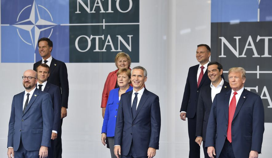 Belgian Prime Minister Charles Michel, French President Emmanuel Macron, Netherland's Prime Minister Mark Rutte, Norway's Prime Minister Erna Solberg, German Chancellor Angela Merkel, NATO Secretary-General Jens Stoltenberg, Poland's President Andrzej Duda, Greek Prime Minister Alexis Tsipras and U.S. President Donald Trump, from left, pose for a photo during a summit of heads of state and government at NATO headquarters in Brussels on Wednesday, July 11, 2018. NATO leaders gather in Brussels for a two-day summit to discuss Russia, Iraq and their mission in Afghanistan. (AP Photo/Geert Vanden Wijngaert)
