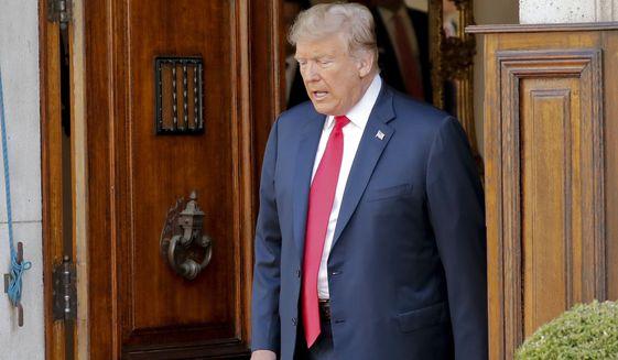U.S. President Donald Trump walks to greet NATO Secretary General Jens Stoltenberg prior to their scheduled bilateral breakfast, Wednesday, July 11, 2018 in Brussels, Belgium. (AP Photo/Pablo Martinez Monsivais)