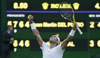Rafael Nadal of Spain celebrates defeating Juan Martin Del Potro of Argentina in their men's quarterfinal match at the Wimbledon Tennis Championships in London, Wednesday July 11, 2018. (AP Photo/Tim Ireland)