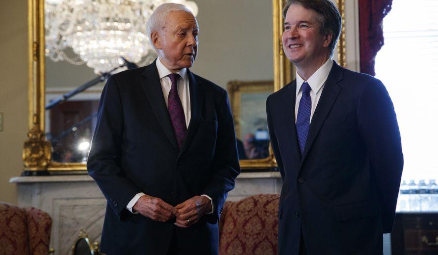 Supreme Court nominee Brett Kavanaugh, right, meets with Sen. Orrin Hatch, R-Utah, on Capitol Hill, Wednesday, July 11, 2018, in Washington. (AP Photo/Evan Vucci)