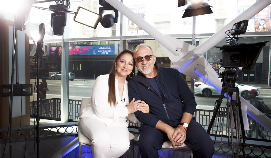 "In this July 9, 2018 photo, Gloria and Emilio Estefan pose for a portrait at BiteSize Studio in Los Angeles to promote their touring musical ""On Your Feet!.""  (Photo by Rebecca Cabage/Invision/AP)"