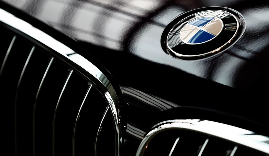 In this Wednesday, March 21, 2018 file photo the logo of German car manufacturer BMW is pictured in Munich, Germany. Automaker BMW said Monday July 9, 2018, it will have to raise prices on the U.S.-built SUVs it sells in China due to 40 percent import tax on cars from the United States,  in retaliation for higher tariffs on Chinese goods imposed by President Donald Trump.((AP Photo/Matthias Schrader, file) **FILE**