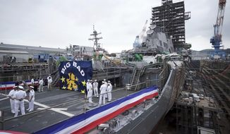In this file photo, the USS John S. McCain is shown in dry dock after a rededication ceremony for at the U.S. Naval base in Yokosuka, southwest of Tokyo, Thursday, July 12, 2018. (AP Photo/Eugene Hoshiko) ** FILE **