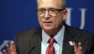 New Kansas athletic director Jeff Long answers questions during a news conference in Lawrence, Kan., Wednesday, July 11, 2018. (AP Photo/Orlin Wagner)
