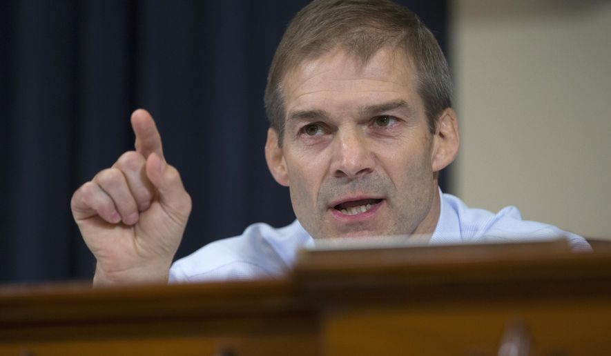 This Oct. 22, 2015, file photo shows U.S. Rep. Jim Jordan, R-Ohio, on Capitol Hill. Two men who were wrestlers at Ohio State University in the 1990s say Jordan isn't being truthful when he says he wasn't aware of allegations team doctor Richard Strauss was groping male wrestlers, NBC reported Tuesday, July 3, 2018. Male athletes from 14 sports at Ohio State have reported alleged sexual misconduct by Strauss, whose 2005 death at the age of 67 was ruled a suicide.  Jordan's spokesman says in a statement the congressman never saw or heard about any abuse or had any abuse reported when he was an assistant wrestling coach at Ohio State. (AP Photo/Carolyn Kaster, File)