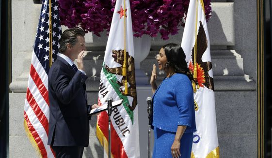 California Lt. Gov. Gavin Newsom, left, swears in London Breed as San Francisco's new mayor Wednesday, July 11, 2018, outside City Hall in San Francisco. The 43-year-old Breed becomes the city's first African American female mayor and she inherits a San Francisco battling homelessness, open drug use and unbearably high housing costs. (AP Photo/Marcio Jose Sanchez)