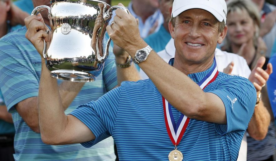 FILE - In this July 1, 2018, file photo, David Toms holds up the trophy after winning the U.S. Senior Open golf tournament at The Broadmoor, in Colorado Springs, Colo. Toms takes aim at the Constellation Senior Players Championship after winning the U.S. Senior Open two weeks ago. That win was his first on the senior or regular tour in more than seven years. (AP Photo/David Zalubowski, File)