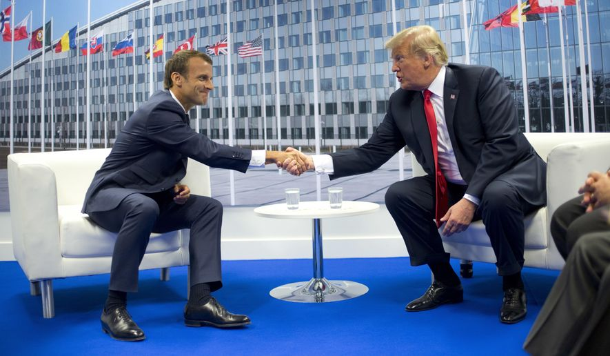 President Donald Trump and French President Emmanuel Macron shake hands during their bilateral meeting, Wednesday, July 11, 2018 in Brussels, Belgium. (AP Photo/Pablo Martinez Monsivais)