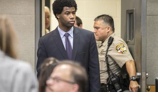 Meechaiel Criner, accused of killing University of Texas student Haruka Weiser in April 2016, is escorted into a courtroom, Wednesday, July 11, 2018 in Austin, Texas. Criner, a 17-year-old foster care runaway at the time of the killing, is on trial for capital murder. He faces a sentence of life in prison if convicted. (Ricardo Brazziell/Austin American-Statesman via AP)