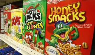 Hold for Business Photo: Boxes of Kellogg's Froot Loops, Corn Pops, Apple Jacks, and Honey Smacks sit on the shelf of a Mt. Lebanon, Pa., grocery store Friday, June 25, 2010. (AP Photo/Gene J. Puskar)